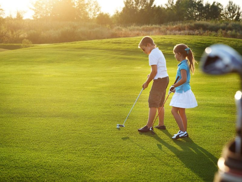 bigstock-Casual-Kids-At-A-Golf-Field-Ho-79961312